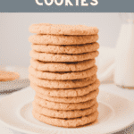 Straight on shot of a stack of snickerdoodle cookies on a white plate.