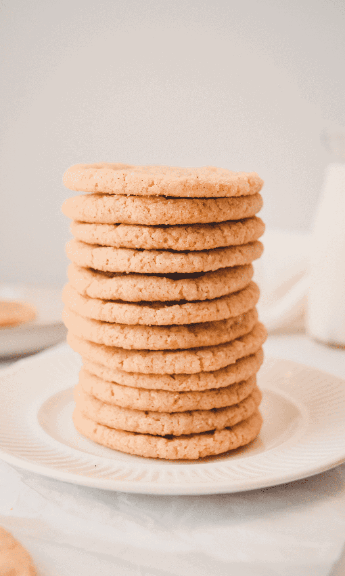 A straight-on shot of snickerdoodles cookies on a white plate.